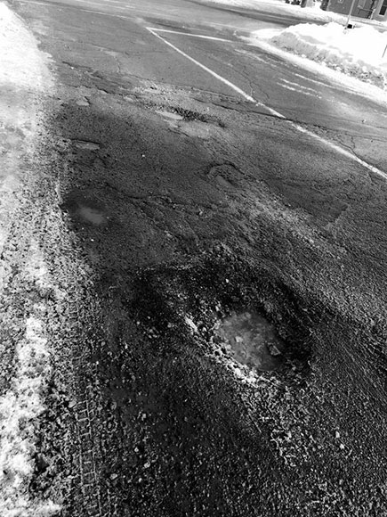 Pothole at Elm Crescent and Main Street. Photo by Greg Banning.