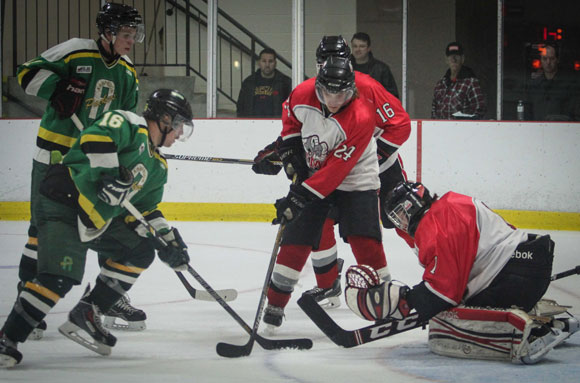 Stittsville Junior Rams goalie Connor Ellis blocks a shot from Arnprior Packers # 16 James Preddle as  Junior Rams #16 Parker Almers and #24 Jack Oliver look on.  Photo by Barry Gray.