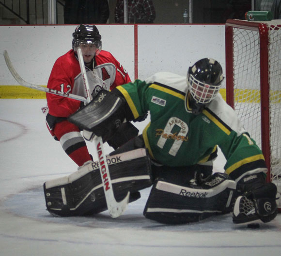 Stittsville Junior Rams goalie  Connor Ellis reaches for the puck in traffic during Sunday afternoon hockey at Goublourn Recrecation Center.  Packers went on to win the game 3-1.         Photo by Barry Gray.