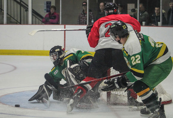 Arnprior Packers goalie Dominic Plaschy smothers the puck after stopping a shot from Stittville Junior Rams  Matt Allan in  Sunday afternoon Junior Hockey at Goublourn Recrecation Center.  Packers went on to win the game 3-1.  Photo by Barry Gray.