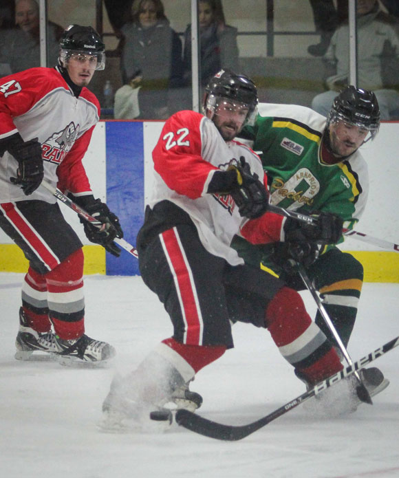 Stittsville Junior Rams #22 Jordan Boutillier fights off Arnprior forward #17 Robert Darnowski. Photo by Barry Gray.