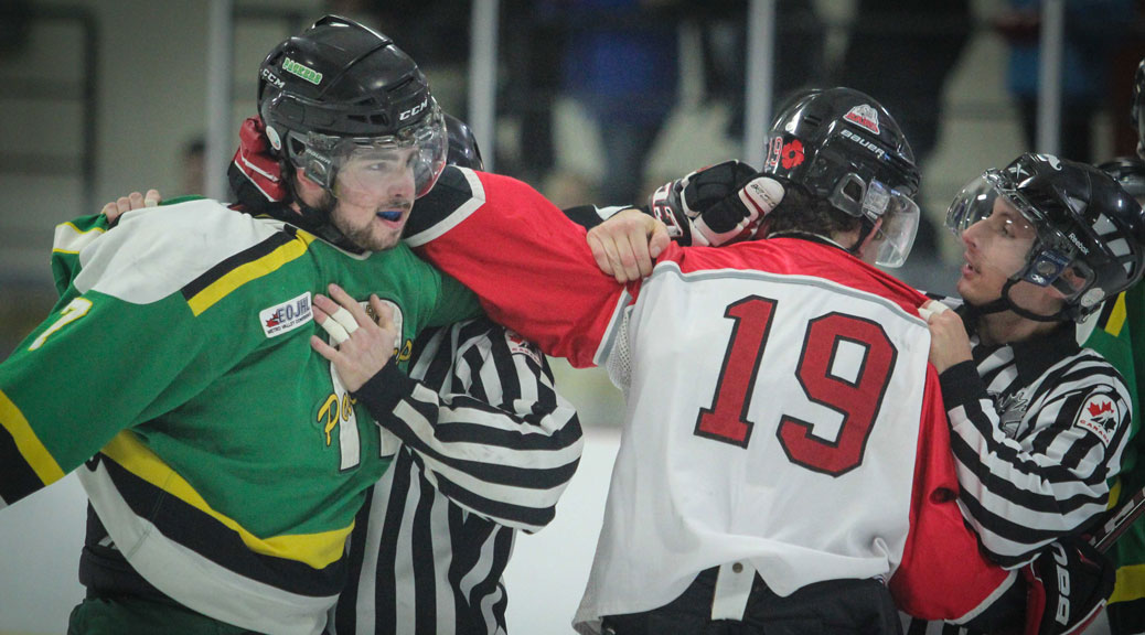 Arnprior Packers defenseman #7 Corey Drisdelle and Stittsville Junior Rams #19 Shane Hiley mix it up in the first period during Sunday afternoon Junior Hockey at Goublourn Recrecation Center. Packers went on to win the game 3-1. Photo by Barry Gray.