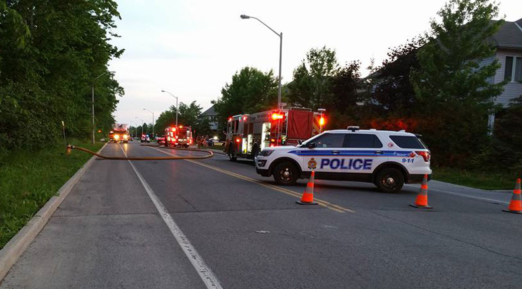 Emergency vehicles respond to a fire on Talltree Crescent on Sunday evening. Photo by Jeffrey Elliott.
