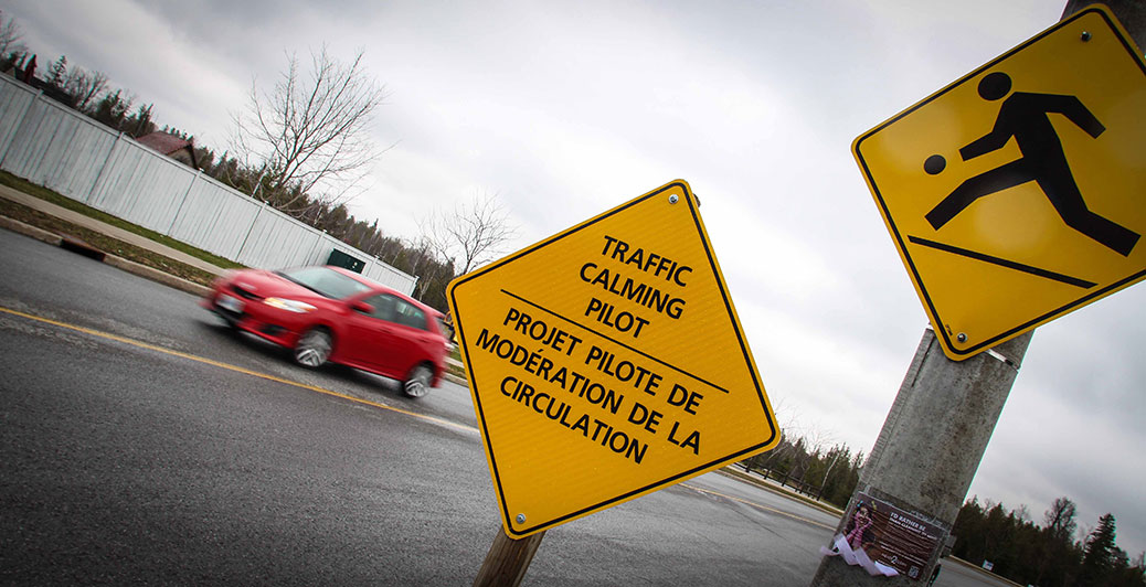 Traffic calming signage along West Ridge. Photo by Barry Gray.