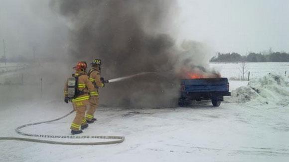 Firefighters extenguish a truck fire on Fallowfield Road. Photo courtesy of Todd Horricks / Ottawa Fire.