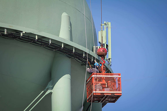 Contractors work on TELUS cell equipment on top of the Stittsville water tower. Photo by Barry Gray.