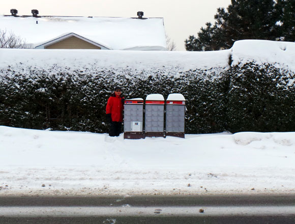 Roger Chagnon stands in a snow bank on West Ridge on February 14 after a snow storm.