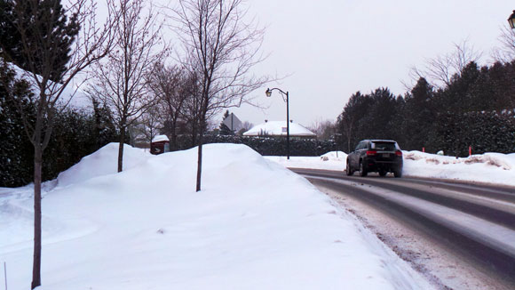 The summer pathway is buried under piles of snow during the winter.