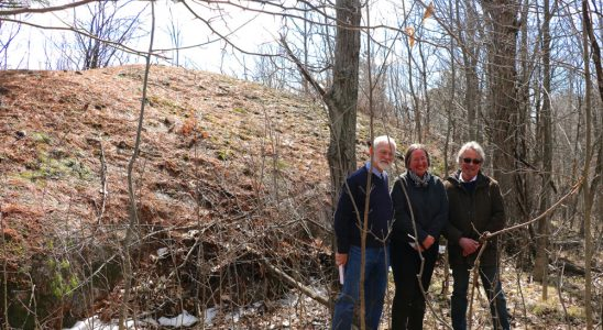 Michael MacPherson, former MMLT board instrumental in securing the land, Carolyn Canfield, and Ian Campbell, neighbour and long time friend to Carolyn. They're standing in front of the whaleback formation of glacier-sculpted Canadian Shield. Photo courtesy of Janet Mason.