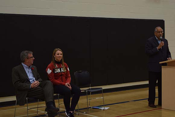 From left: Mayor Jim Watson, Erica Wiebe and Councillor Shad Qadri