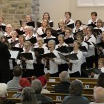 West Ottawa Ladies Chorus sings the anthem at City Hall on January 31