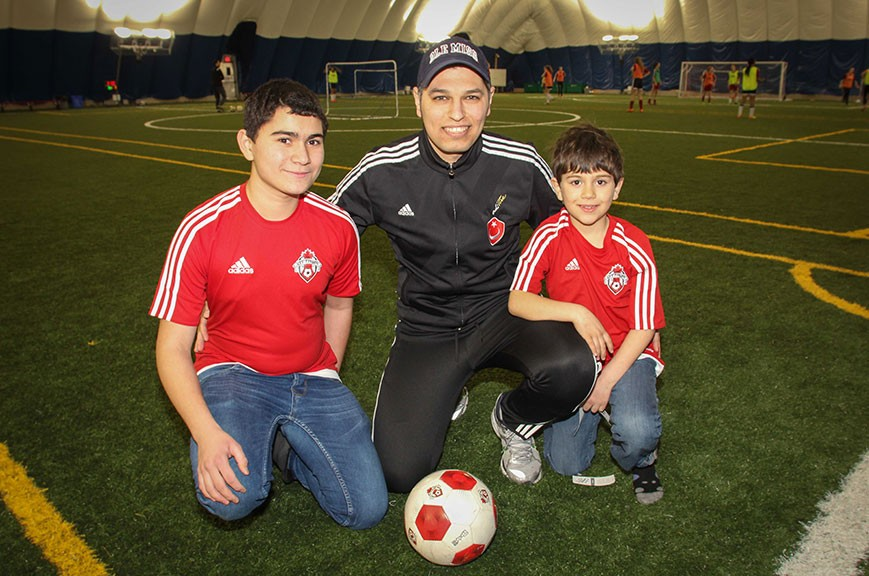 Eihab Altalli (left) and Obai Altalli (right) from Syria, along with Ahmed Aref from West Ottawa Soccer Club. Photo by Barry Gray.