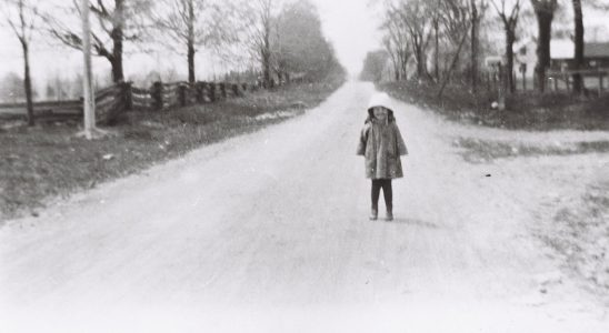 A child standing on what's now Hazeldean Road, east of Terry Fox. Photo from the collection of Roger Young.